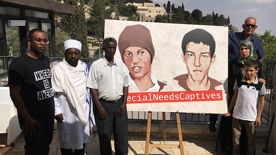 Family members of Avera Mangistu (at left in illustration) call on the United Nations to facilitate his release from the Gaza Strip. Credit: Josh Hasten.