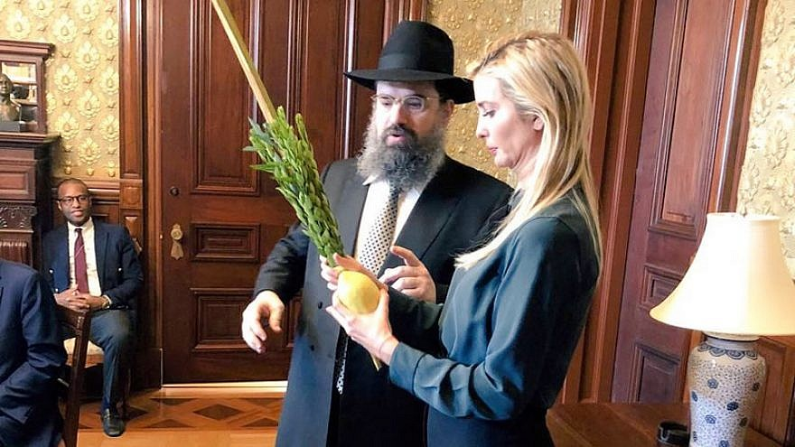 Ivanka Trump is assisted waving the lulav and etrog at the White House during the eight-day holiday of Sukkot by Rabbi Levi Shemtov, executive vice president of American Friends of Lubavitch (Chabad). Source: Twitter.