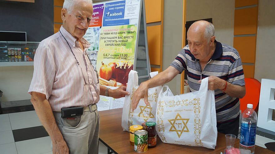 A volunteer in Kharkov, Ukraine, helps package High Holiday supplies for elderly Jews in need in the former Soviet Union. September 2018. Credit: JDC Photo.