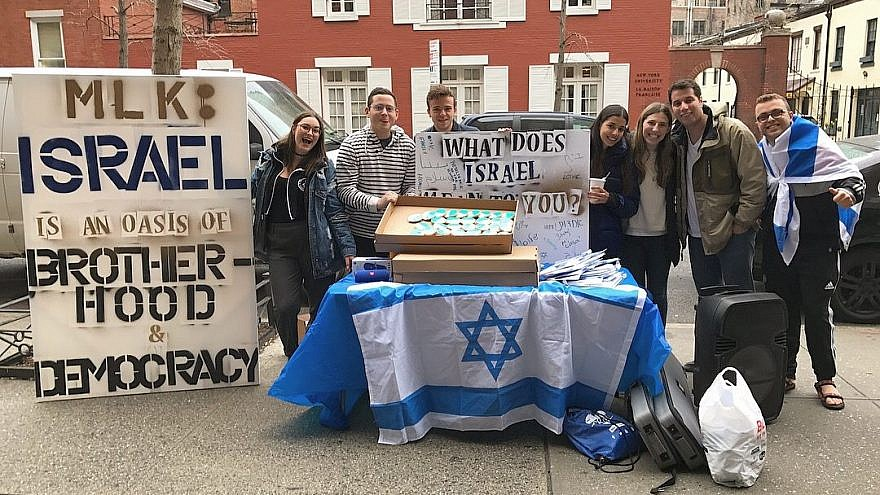 "At New York University, pro-Israel students hold a counter-demonstration that raises awareness about Israeli democracy, diversity and other positive attributes of the Jewish state. Encouraging students to publicly counter anti-Israel protests is part of the Maccabee Task Force's strategy of ""taking back the quad."" Credit: Maccabee Task Force."
