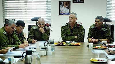 Israel Defense Forces Chief of Staff Lt. Gen. Benny Gantz (center) evaluates the security situation on a visit to the Southern Command and Gaza Division. The meeting was attended by commander of the Southern Command, Maj. Gen. Tal Russo, and IDF Spokesman Brig. Gen. Yoav Mordechai. Aug. 19, 2011. Credit: Flickr/Israel Defense Forces via Wilkimedia Commons.