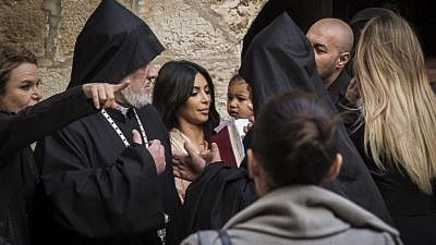 Celebrity Kim Kardashian, seen with her child, North, is greeted by priests at the Saint James Armenian Church in the Armenian Quarter in Jerusalem's Old City. Kardashian, of Armenian descent, and her husband, rapper Kanye West, came to Israel to baptize their child there on April 13, 2015. Photo by Hadas Parush/Flash90.