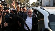 Hamas leader Ismail Haniyeh flashes the victory gesture upon his arrival at the Rafah border crossing from Egypt after reconciliation talks with the Fatah movement mediated by Egyptian intelligence in southern Gaza, Sept. 19, 2017. Photo by Abed Rahim Khatib/Flash90.