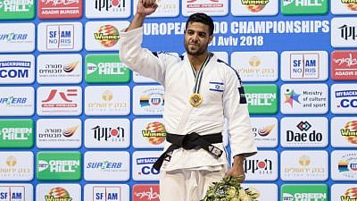 Israel's Sagi Muki earns the gold medal on the podium after winning in the men's under 81 kg-weight category during the European Judo Championship in Tel Aviv on April 27, 2018. Photo by Roy Alima/Flash90.