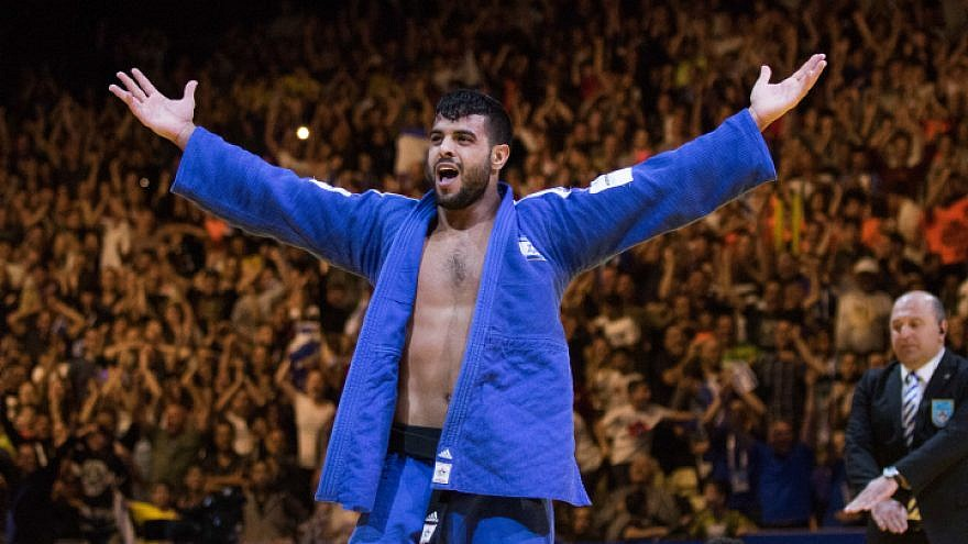 Israel's Sagi Muki raises his hands as he celebrates after winning in the men's under-81 kilograms weight category during the European Judo Championship in Tel Aviv on April 27, 2018. Photo by Roy Alima/Flash90.