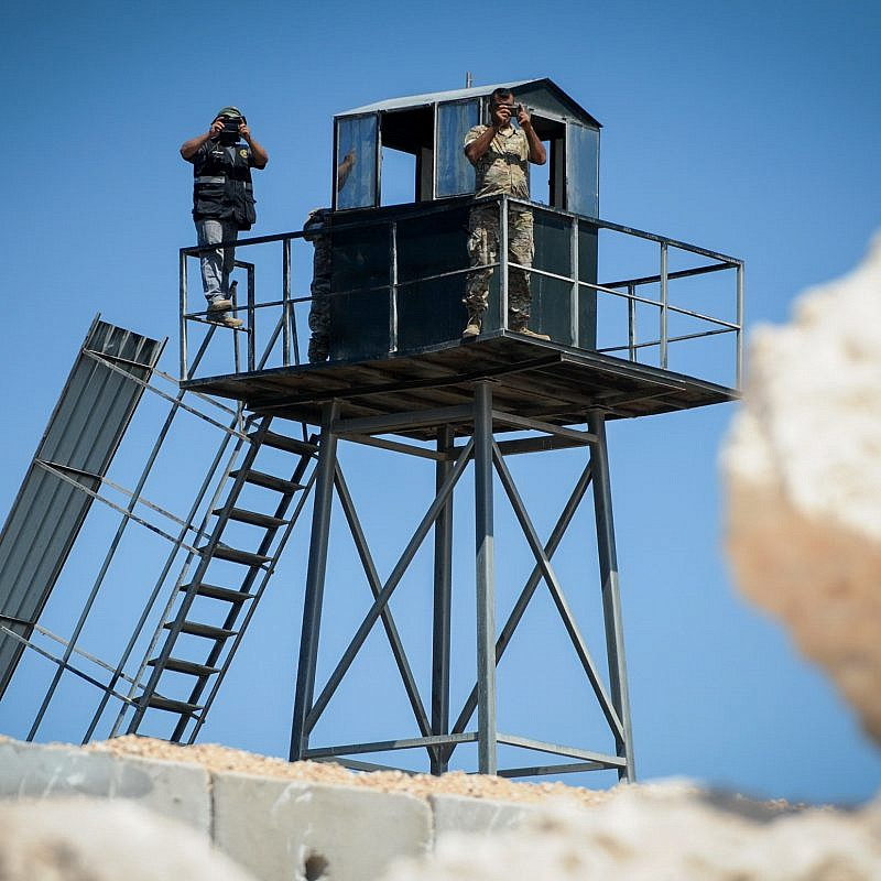 Lebanese soldiers and a member of the Hezbollah organization (left) on a watch tower near the new concrete wall on the border between Israel and Lebanon near Rosh Hanikra in northern Israel on Sept. 5, 2018. Photo by Basel Awidat/Flash90.