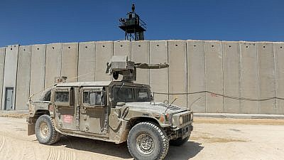 An Israeli army vehicle drives near a new concrete wall on the border between Israel and Lebanon near Rosh Hanikra in northern Israel on Sept. 5, 2018. Photo by Basel Awidat/Flash90.