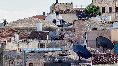 People rest on a rooftop in Jerusalem's Old City on Sept. 7, 2018. Photo by Dario Sanchez/Flash90.