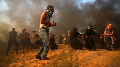 Palestinian protesters clash with Israeli security forces near the Gaza-Israel border on Sept. 28, 2018. Photo by Abed Rahim Khatib/Flash90.