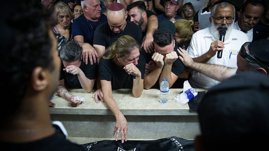 Family and friends attend the funeral of 29-year-old Kim Levengrond Yehezkel in her hometown of Rosh Ha'ayin on Oct. 7, 2018. Yehezkel was shot dead earlier in the day by a Palestinian terrorist at the Barkan Industrial Park in Samaria, along with 35-year-old Ziv Hajbi of Rishon Letzion. Photo by Yonatan Sindel/Flash90.