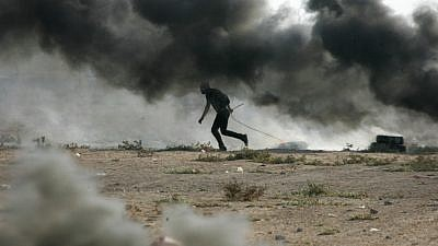 Palestinian demonstrators burn tires as they demonstrate on the Gaza-Israel border on Oct. 12, 2018. Photo by Abed Rahim Khatib/Flash90.