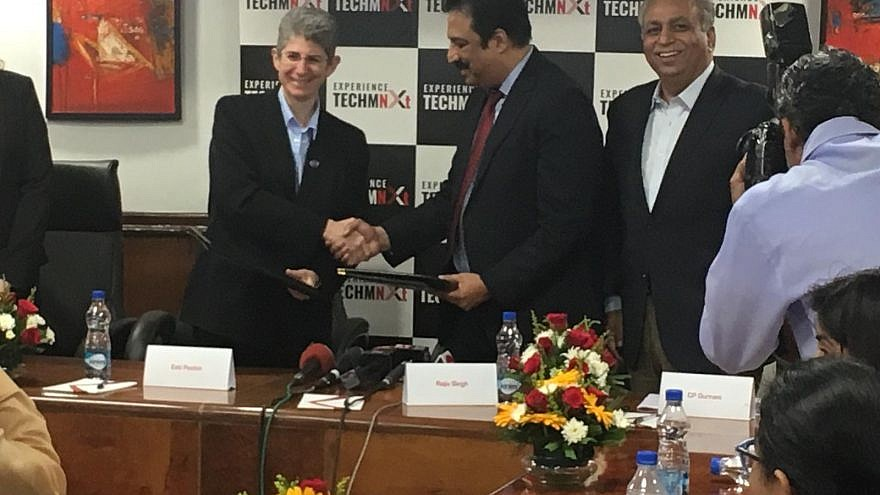 "Esti Peshin, vice president and general manager of IAI's Cyber Division, shakes hands with Rajiv Singh at a ""Memorandum of Understanding"" signing ceremony in New Delhi, India, on Oct. 3, 2018. Credit: IAI."