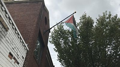 The Palestinian flag moments before being taken down from the PLO Mission in Washington in advance of its being ordered closed by the Trump administration, Oct. 10, 2018. Credit: Jackson Richman/JNS.