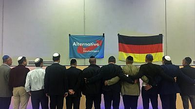 "Members of the new Jewish factions for Germany's far-right AfD Party sing the traditional Jewish song ""Oseh Shalom"" on stage together. Credit: Orit Arfa."