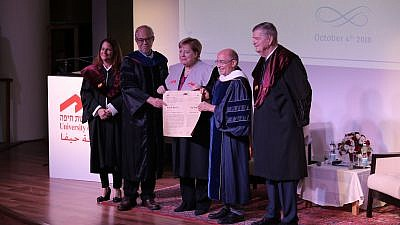 German Chancellor Angela Merkel (center) is presented with an honorary doctorate from the University of Haifa. Credit: University of Haifa.