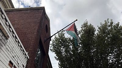 The Palestinian flag just moments before being taken down from the PLO Mission in Washington on Oct. 10, 2018. The Trump administration last month ordered the office to be closed. Credit: Jackson Richman/JNS.