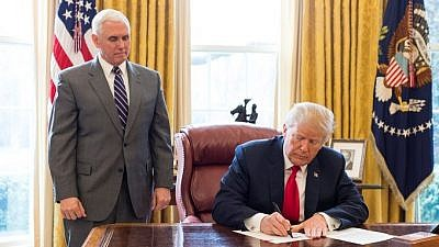 U.S. President Donald J. Trump, joined by Vice President Mike Pence, signs an executive order on March 19, 2018, in the Oval Office at the White House, to take additional steps to stop the Maduro regime in Venezuela from attempting to circumvent U.S. sanctions by issuing a digital currency. Credit: Official White House Photo by Joyce N. Boghosian.