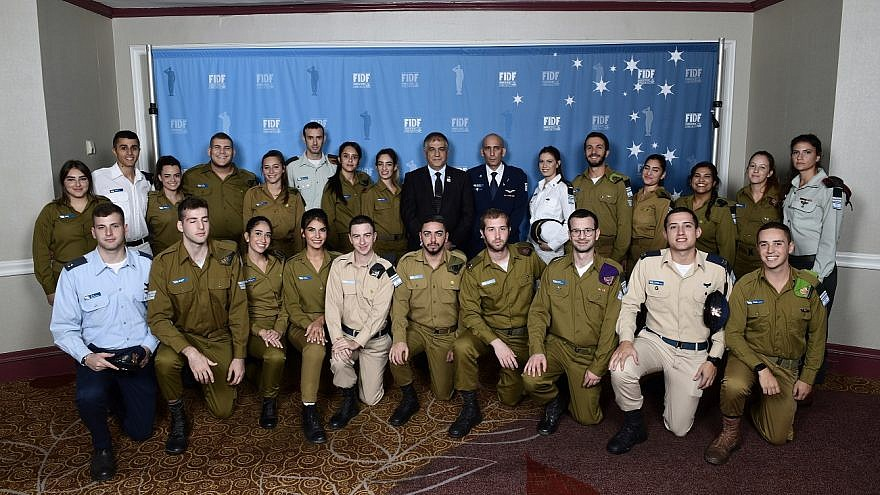 FIDF national director and CEO Maj. Gen. (Res.) Meir Klifi-Amir; Brig. Gen. Tal Kelman, head of the Strategic Division of the IDF Planning Directorate and former Chief of Staff in the Israeli Air Force (IAF); with Israeli soldiers at the 2018 FIDF National New York Gala Dinner on Oct. 17, 2018. Credit: Shahar Azran.