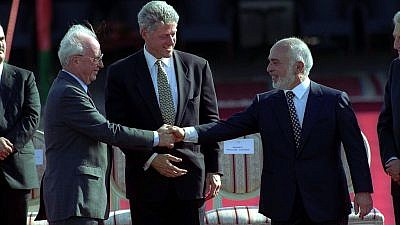 U.S. President Bill Clinton is flanked by Jordan's King Hussein and Israeli Prime Minister Yitzhak Rabin, shaking hands in October 1994. Source: Israel Government Press Office.