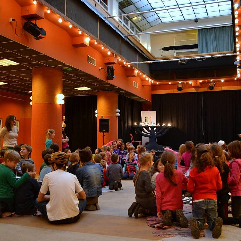 A Hanukkah celebration at the JCC in Budapest, known as the Balint House. Credit: JDC.