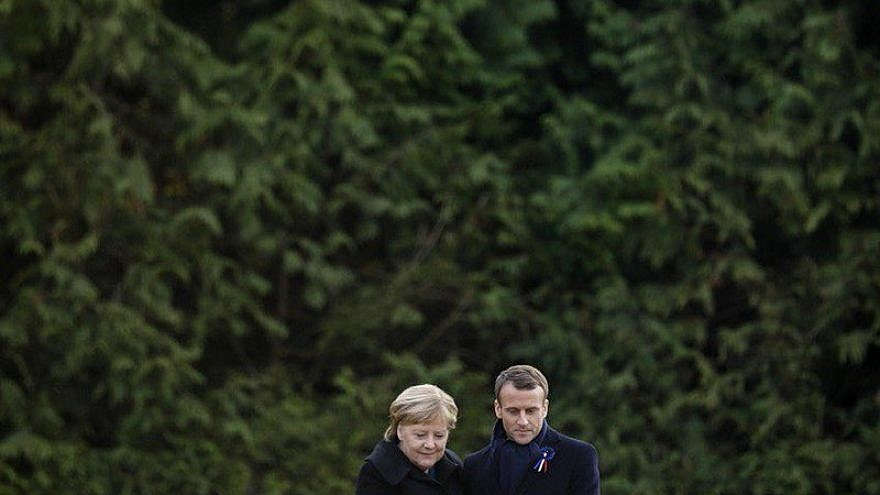 French President Emmanuel Macron and German Chancellor Angela Merkel embrace at a ceremony commemorating the centennial of the end of World War I. Credit: Emmanuel Macron via Twitter.