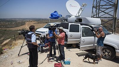 "Media representative broadcast from the Israel Gaza border, on the second day of ""Operation Protective Edge,"" July 9, 2014. Credit: Yonatan Sindel/Flash90."