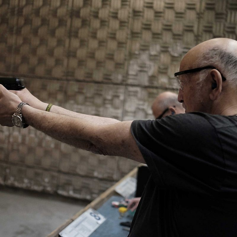Israelis practice shooting handguns at the Olympic Shooting Range in Herzeliya. Photo by Tomer Neuberg/FLASH90