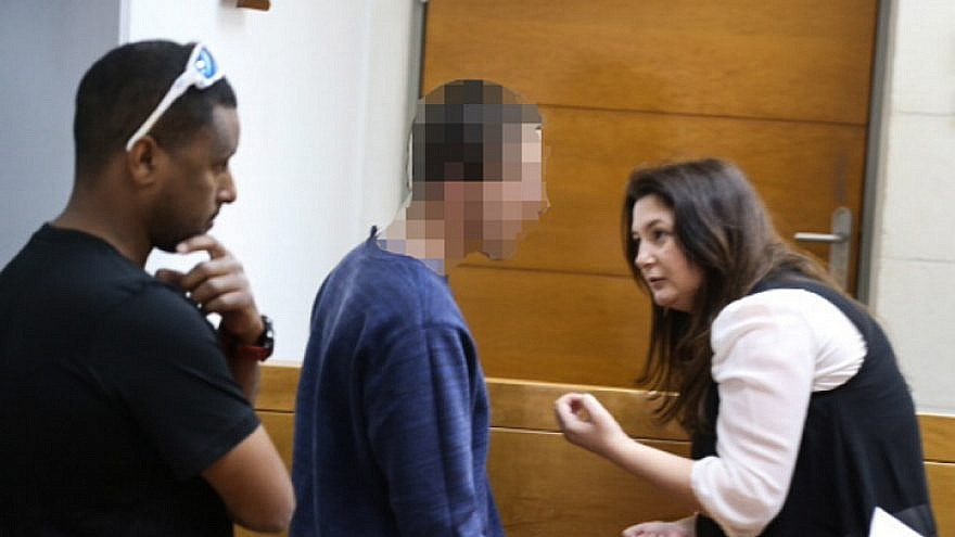 A man brought for a court hearing at the Rishon Lezion Magistrate's Court, under suspicion of Issuing fake bomb threats against Jewish institutions around the world, on March 23, 2017. Photo by Flash90.