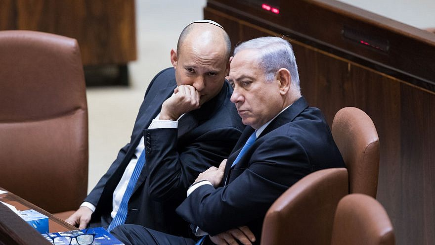 Israeli Prime Minister Benjamin Netanyahu speaks with then-Education Minister Naftali Bennett during a plenum session at the Knesset on Nov. 13, 2017. Photo by Yonatan Sindel/Flash90.