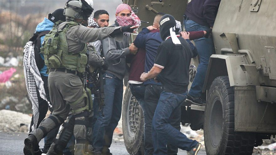 Illustrative: Israeli undercover troops arrest a Palestinian man during a protest in the West Bank City of Ramallah against U.S. President Donald Trump's latest decision to recognize Jerusalem as the capital of Israel, Dec. 13, 2017. Photo by Flash90.