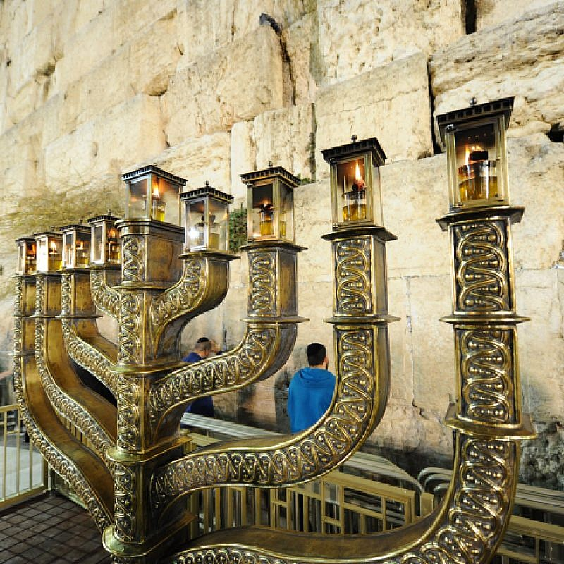 View of Hanukkah menorah on the last night of the eight-day Jewish holiday, at the Western Wall in the Old City of Jerusalem, on Dec. 19, 2017. Photo by Mendy Hechtman/Flash90.