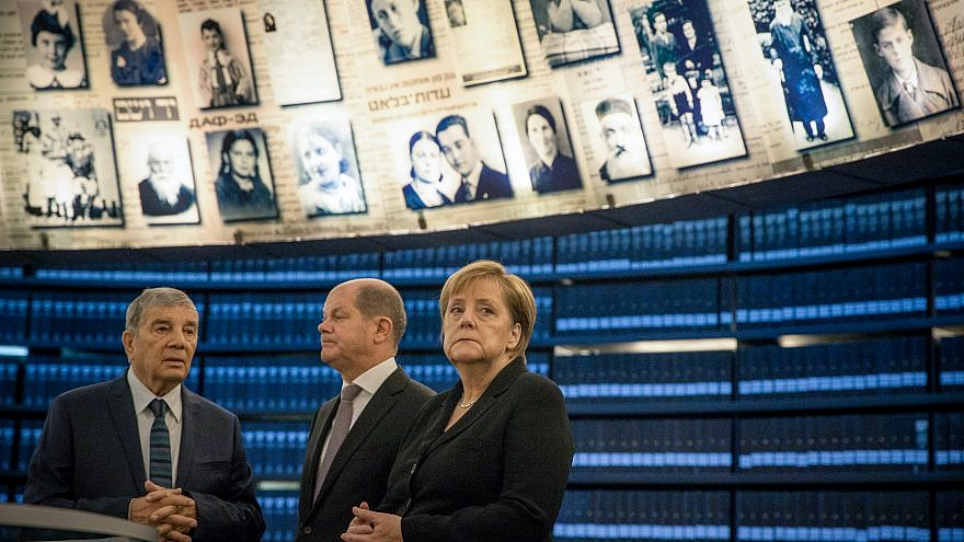 German Chancellor Angela Merkel at the Hall of Names during her visit at the Yad Vashem Holocaust memorial in Jerusalem on October 4, 2018. Credit: Oren Ben Hakoon/POOL