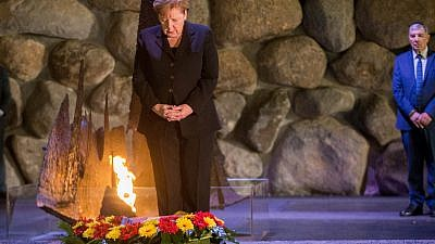 German Chancellor Angela Merkel lays a wreath during a ceremony at the Hall of Remembrance in the Yad Vashem Holocaust memorial in Jerusalem on Oct. 4, 2018. Photo by Oren Ben Hakoon/POOL.