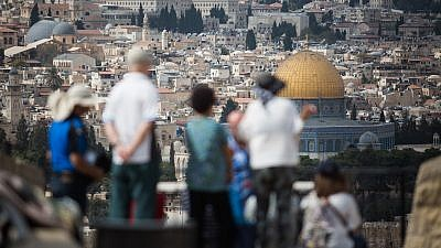 Tourists take in the view of the Dome of the Rock and Temple Mount from the Mount of Olives platform overlooking the Old City of Jerusalem, on Oct. 11, 2018. Photo by Hadas Parush/Flash90.