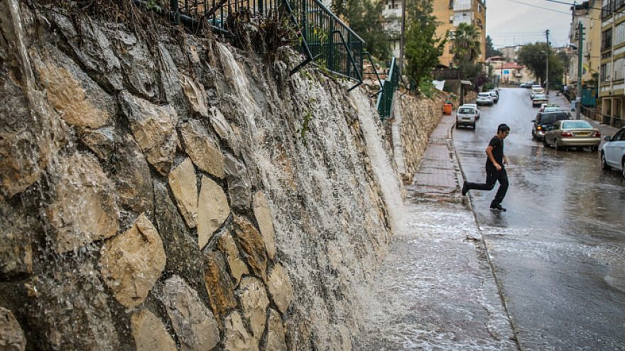 View of water streaming from the first rains of the winter season in the northern Israeli city of Tzfat on Oct. 19, 2018. Photo by David Cohen/Flash90.