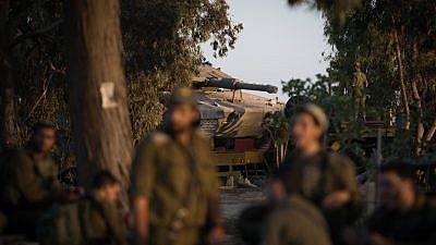 Israeli soldiers rest close to Kibbutz Nir Oz in southern Israel, near the border with Gaza. An Israeli army officer and seven Palestinians, including a local Hamas commander, were killed following an incursion by Israeli special forces into the Gaza Strip. Nov. 12, 2018. Photo by Hadas Parush/Flash90.
