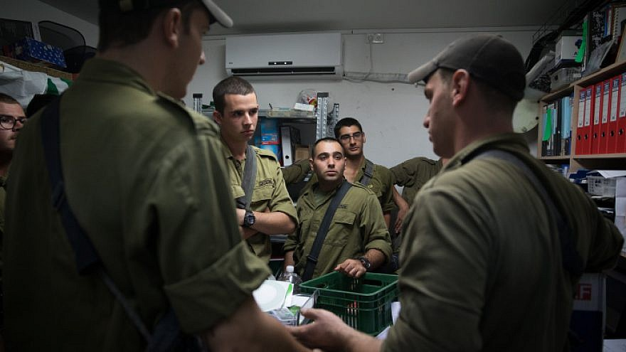 Israeli soldiers stand inside a street-level bomb shelter as a siren warns of incoming rockets fired from Gaza into Israel on Nov. 12, 2018. Photo by Hadas Parush/Flash90.