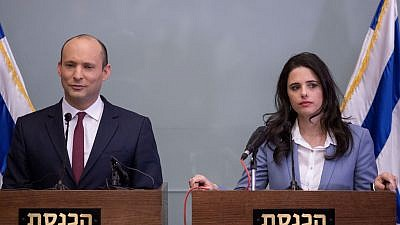 Israeli Education Minister Nafatli Bennett and Justice Minister Ayelet Shaked deliver a statement during a press conference in the Israeli parliament on Nov. 19, 2018. Credit: Miriam Alster/Flash90.
