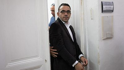 """Palestinian Authority Jerusalem """"governor"""" Adnan Ghaith is escorted by police after a court hearing at the Magistrate's Court in Jerusalem on Nov. 25, 2018. Photo by Yonatan Sindel/Flash90."""