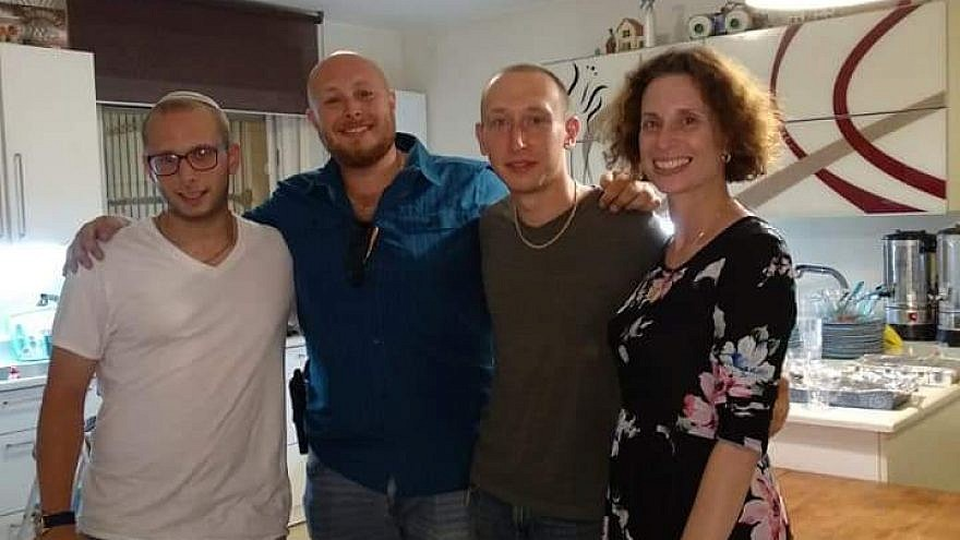Hadassah Sabo Milner, a mom of three lone soldiers in the Israel Defense Forces (one of whom just completed his service) who lives with her youngest son and husband in New York, is pictured with her sons Naff, Aryeh and Avraham. Credit: Courtesy.
