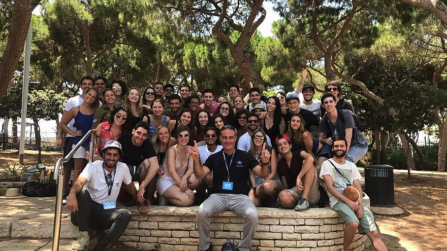 Birthright CEO Gidi Mark posing with trip participants in Israel. Credit: Courtesy.