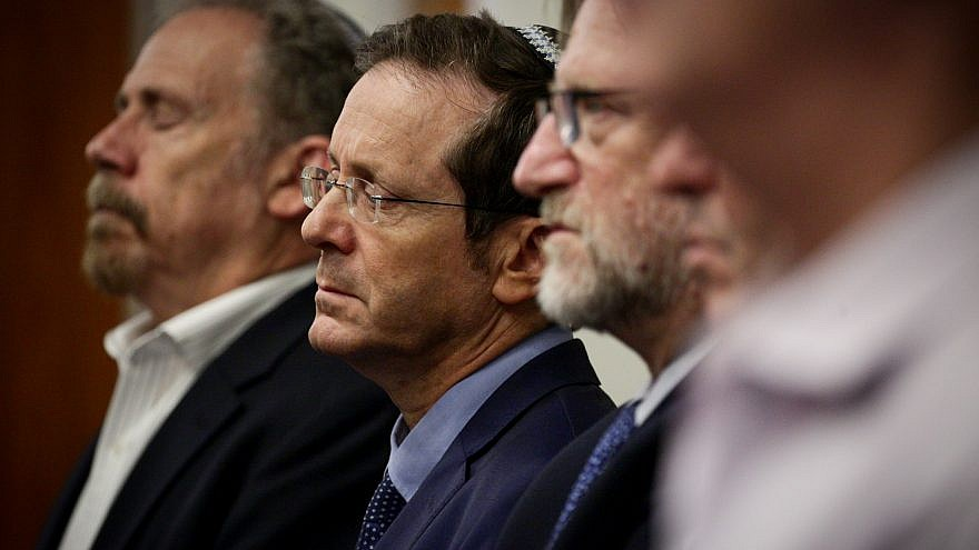 Jewish Agency chairman Isaac Herzog (center) attends an Oct. 29 memorial service in Jerusalem for the 11 Jewish worshippers killed in a shooting attack the day before at the Tree of Life*Or L'Simcha Synagogue. He is flying to Pittsburgh to spend Nov. 2-4, 2018, with the families and community in mourning. Photo by Aharon Krohn/Flash90.