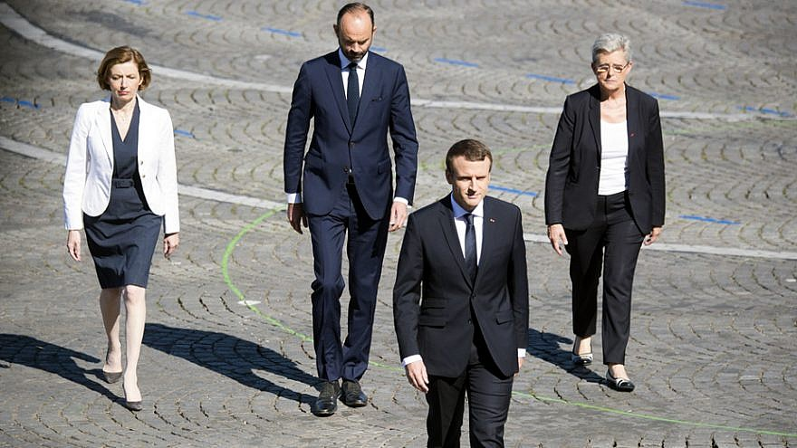 French President Emmanuel Macron heads to the reviewing stand for the annual Bastille Day military parade in Paris on July 14, 2017. Credit: Department of Defense Photo by Navy Petty Officer 2nd Class Dominique Pineiro.