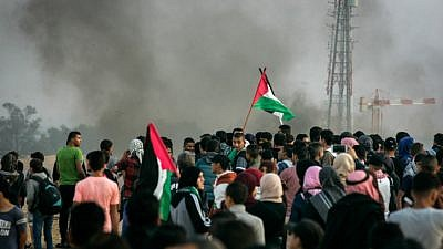 """Palestinians take part in a """"March of Return"""" demonstration near Al Bureij Refugee Camp on the Gaza-Israel border, in east of Rafah in the southern Gaza Strip, on Nov. 9, 2018. Photo by Abed Rahim Khatib/Flash90."""