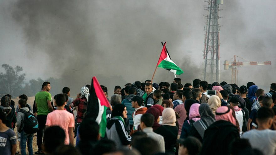 "Palestinians take part in a ""March of Return"" demonstration near Al Bureij Refugee Camp on the Gaza-Israel border, in east of Rafah in the southern Gaza Strip, on Nov. 9, 2018. Photo by Abed Rahim Khatib/Flash90."