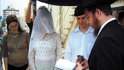 Rabbi Gavriel Holtzberg (right) officiates at a wedding in Mumbai as his wife, Rivka (left) looks on. The Holtzbergs, the founders and directors of Chabad-Lubavitch of Mumbai, were killed along with four guests during a brutal attack on their center 10 years ago. Credit: Chabad.org.