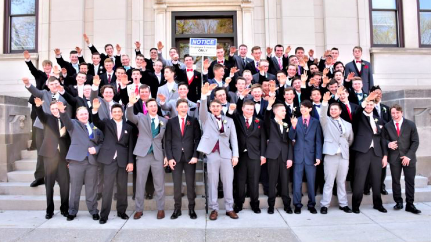 """Male students from Baraboo High School in Baraboo, Wis., pose for junior prom photo doing the """"Sig Heil"""" Nazi salute in 2017. The picture went viral on Nov. 12, 2018. Credit: Screenshot."""
