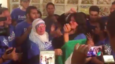 Democratic congresswoman-elect Rashida Tlaib is wrapped in a Palestinian flag by her mother at a celebratory party after winning the race in Michigan's 13th congressional district on Nov. 8, 2018. Credit: Screenshot.