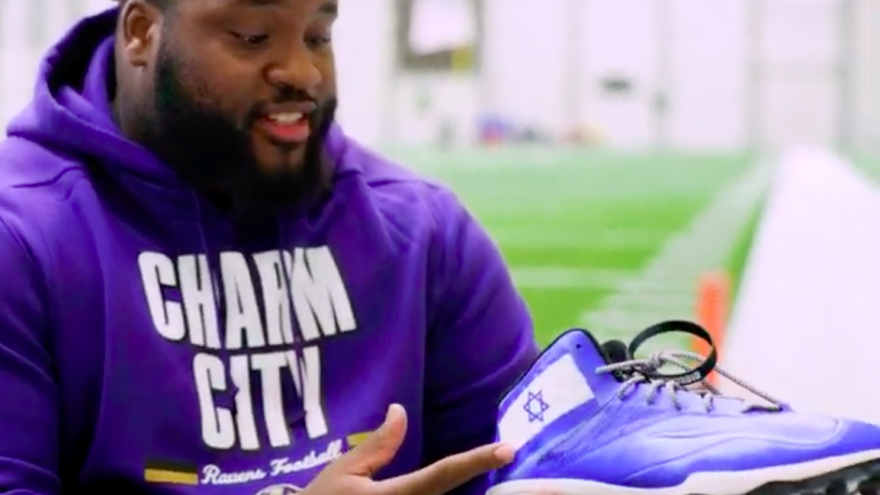 """Baltimore Ravens defensive tackle Michael Pierce shows his customized cleats, partnering with the Israel Collective as part of the National Football League's """"My Cause, My Cleats"""" campaign. Credit: Screenshot."""