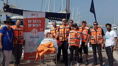 """United Hatzalah """"Ten Kavod"""" volunteers from Kfar Saba set out on a mission to improve an elderly water sports enthusiast's quality of life by helping him experience the sea in a way he had not done since a life-changing double amputation. November 2018. Credit: United Hatzalah."""